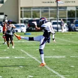 Broncos P Marquette King kicks one away during drills.