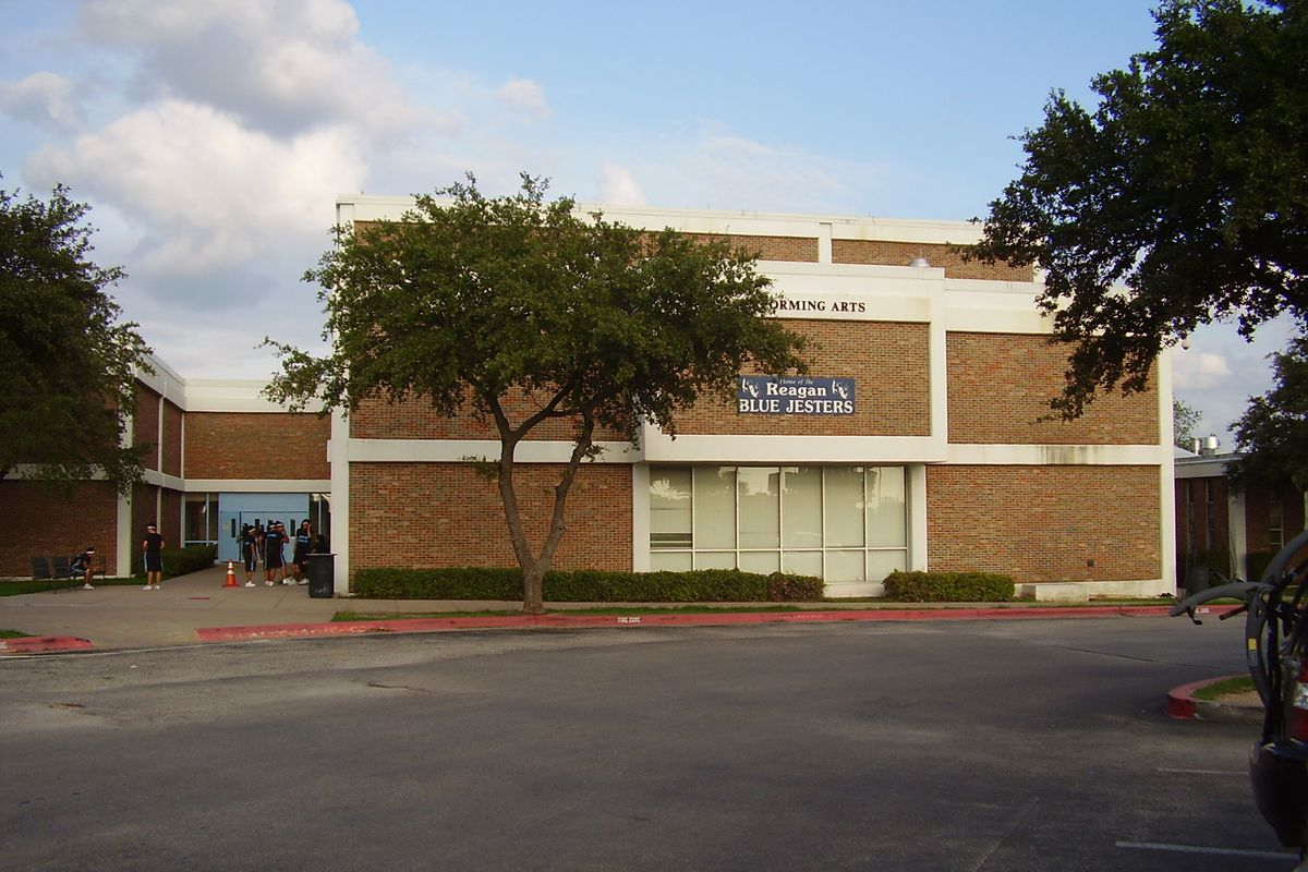 """Two-story building with """"Performing Arts"""" banner"""