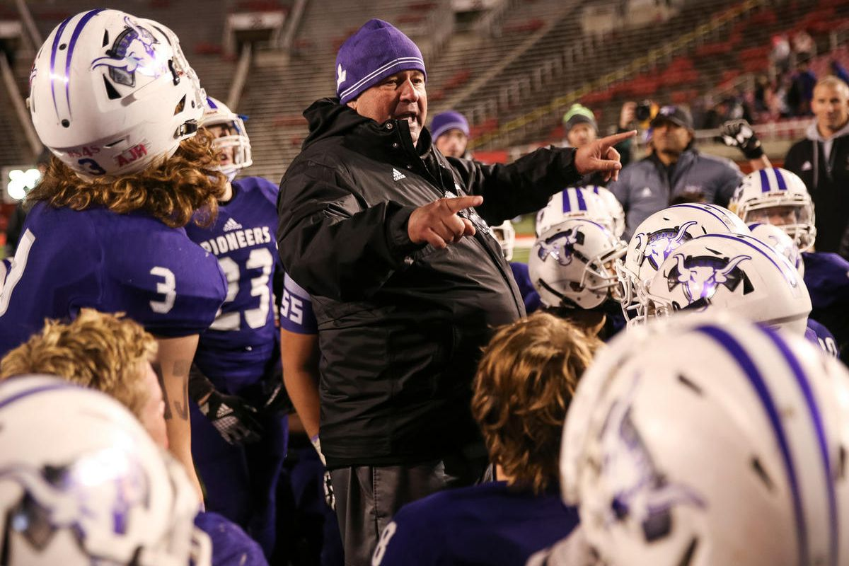 Head coach Ed Larson talks to the team as Lehi celebrates their 55-17 win over Skyridge in the 5A football state championship game at Rice-Eccles Stadium in Salt Lake City on Friday, Nov. 17, 2017.