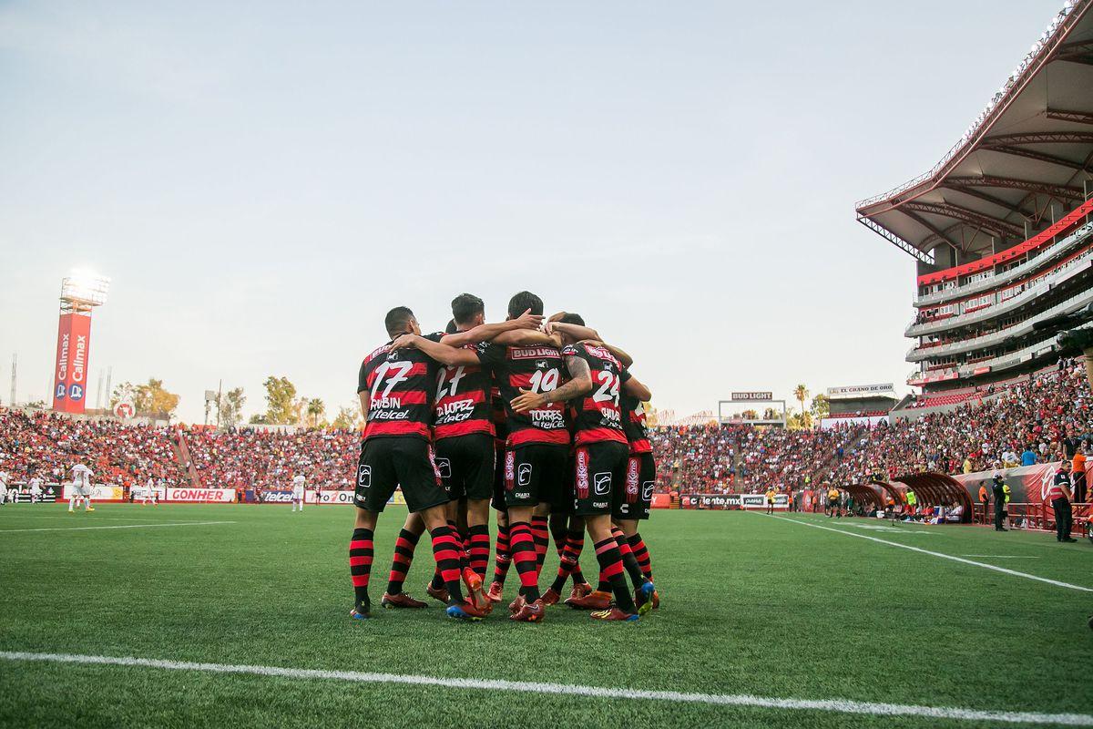Club Tijuana celebrates a goal at a packed Estadio Caliente in a Copa MX match against Toluca.