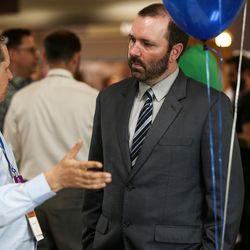 Carl Ingwell, candidate for the 3rd Congressional District, talks to a conventiongoer at the Utah Democratic Party State Organizing Convention at Weber State University in Ogden on Saturday, June 17, 2017.
