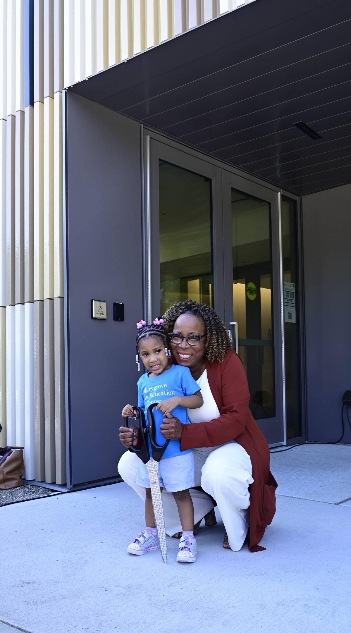 Principal Celina Byrd poses with student Ariyah Small at the grand opening of Marygrove Early Education Center in Detroit.