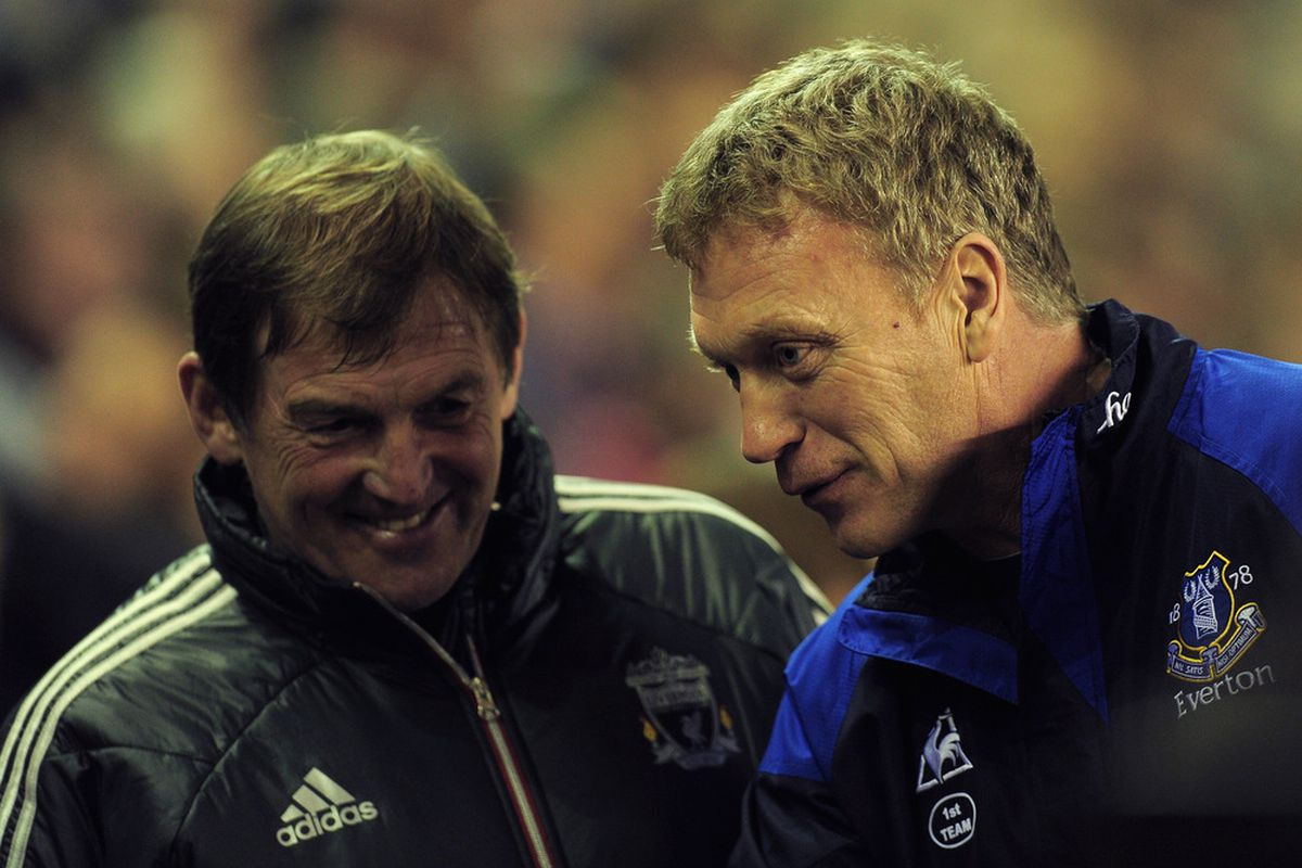 Liverpool manager Kenny Dalglish and Everton manager David Moyes share a laugh ahead of an earlier clash between Liverpool and Everton.  (Photo by Jamie McDonald/Getty Images)