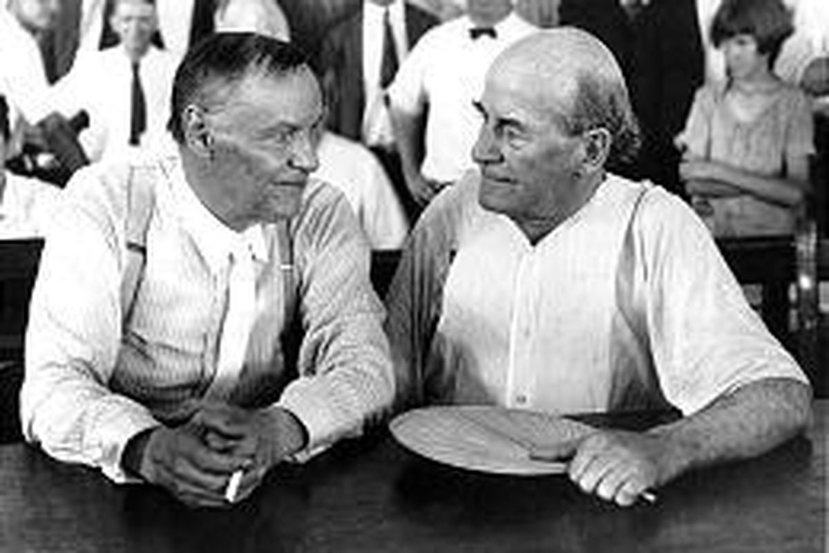 Clarence Darrow, left, and William Jennings Bryan sit next to each other at the Scopes Monkey Trial in this 1925 photo. Darrow was sent by the ACLU to defend a biology teacher who taught evolution.