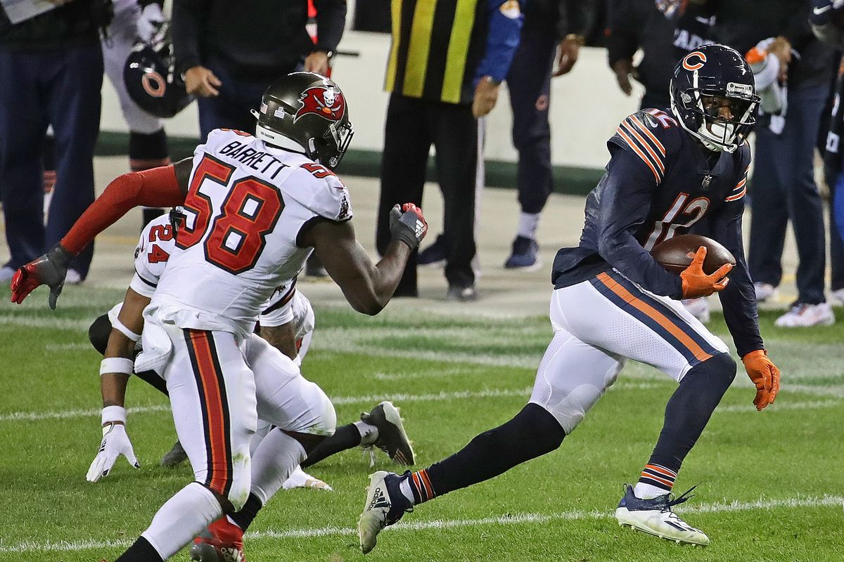 Allen Robinson #12 of the Chicago Bears is chased by Shaquil Barrett #58 of the Tampa Bay Buccaneers after a catch at Soldier Field on October 08, 2020 in Chicago, Illinois. The Bears defeated the Bucs 20-19.
