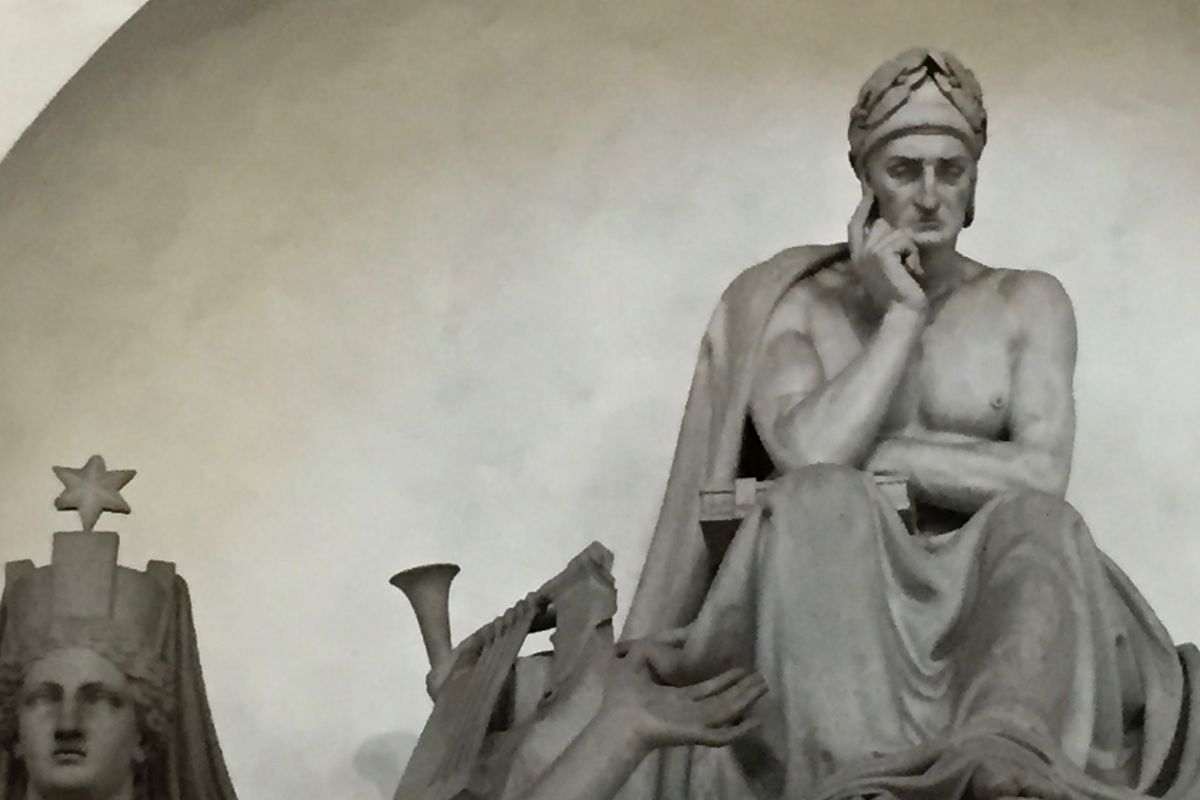 """A statue of Dante atop his faux tomb at the Basilica di Santa Croce in Florence. He's actually buried 90 miles away in Ravenna. Look familiar? Rodin based his """"Thinker"""" on Dante."""