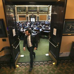 Harry Hansen, communications specialist for the Utah House of Representatives, walks out of the House chambers as legislators attend a special session in person and virtually to deal with myriad COVID-19 budget changes at the Capitol in Salt Lake City on Thursday, June 18, 2020.