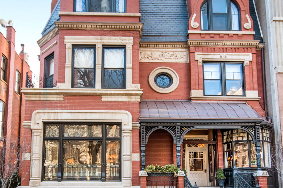 An three-story single-family home with historic trim, windows, moldings, and turrets.