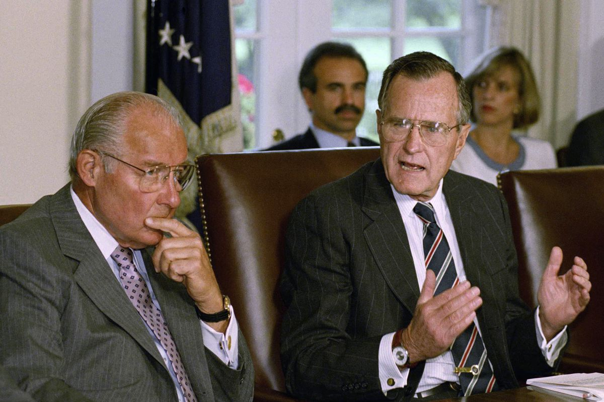 In this 1992 photo, House Minority leader Bob Michel, R-Ill. (left), is shown with President George H.W. Bush in the Cabinet Room of the White House.   Associated Press file photo