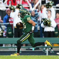 Waubonsie Valley's Antonio Torres (25) breaks a long run for a touchdown against Neuqua Valley.
