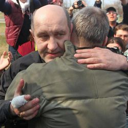 Belarusian opposition activist Dmitry Bondarenko embraces a supporter in Minsk, Belarus, Sunday, April 15, 2012.  Bondarenko was released from prison Sunday in a move that followed crippling sanctions introduced by the West in response to a crackdown on dissent by the country's authoritarian president.