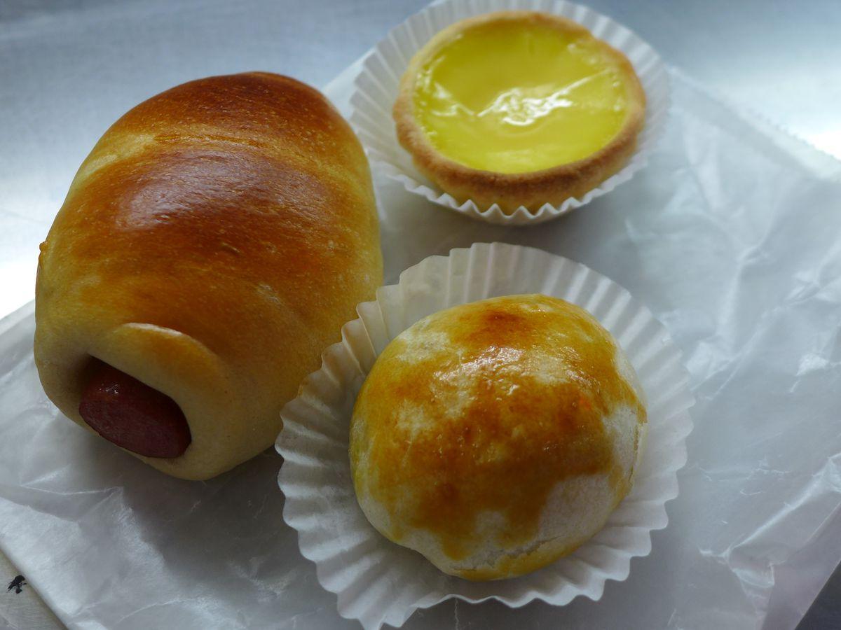 Assorted dim sum, including a custard pie and a hot dog roll
