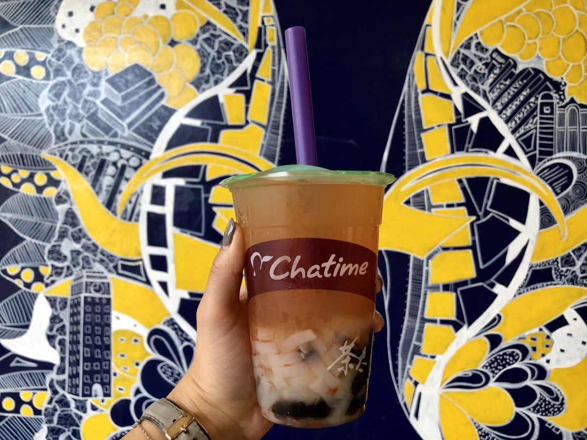 Chatime's Grapefruit QQ drink, featuring lychee jellies and tapioca pearls, against a blue and yellow patterned background.