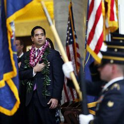 Attorney General Sean D. Reyes participates in a flag ceremony during his inauguration at the Capitol in Salt Lake City, Monday, Jan. 5, 2015.