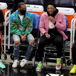 Utah Jazz guards Mike Conley, left, Donovan Mitchell, both currently injured, talk and laugh as they sit on the bench as the Jazz and the Portland Trail Blazers play an NBA basketball game at Vivint Arena in Salt Lake City on Wednesday, May 12, 2021.