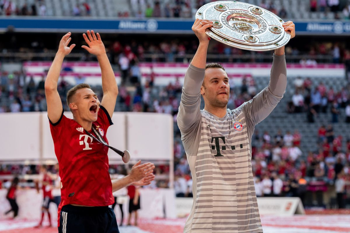 MUNICH, GERMANY - MAY 12: Goalkeeper Manuel Neuer of FC Bayern Muenchen and Joshua Kimmich of FC Bayern Muenchen celebrate with the trophy the 28th German football championship after the Bundesliga match between FC Bayern Muenchen and VfB Stuttgart at Allianz Arena on May 12, 2018 in Munich, Germany.