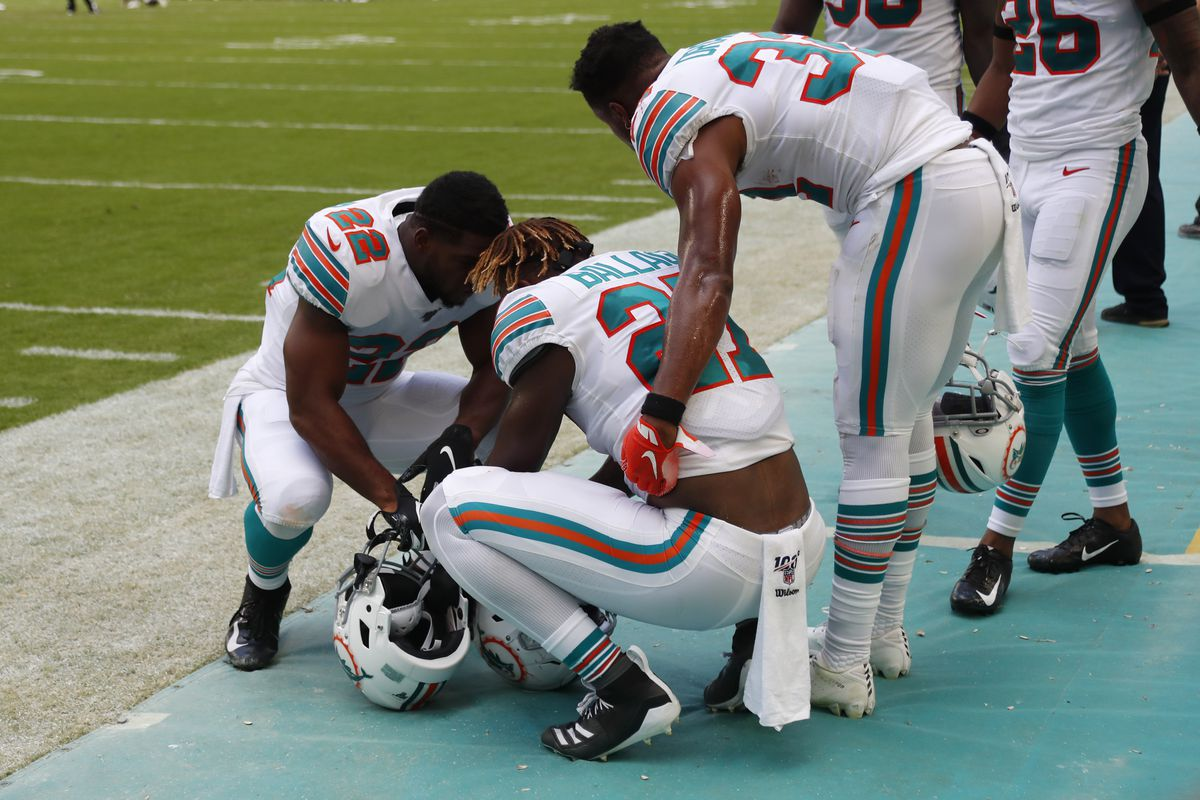 Miami Dolphins running backs Mark Walton and Kenyan Drake, console running back Kalen Ballage.