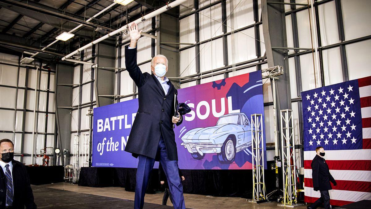 Joe Biden walking and waving.