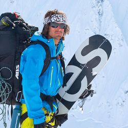 """This April 10, 2010 photo provided by Protect Our Winters shows Jeremy Jones at the Fairweather Mountains near Yakutat, Alaska. The backcountry snowboarder says he's seen the effects of climate change up close in 18 years of heading to Alaska for deep powder in the winter. """"Our season ends a week earlier than it used to. The glacier we use to land on, we can't anymore,"""" Jones said. It's part of the reason he formed Protect Our Winters in 2007 to unite snowboarders and skiers behind saving what they love. Coming off a ski season with weak snowfall in much of Colorado, Utah and the Northeast, there's a sense of urgency to what the group wants to do next, namely making Congress pay more attention to climate change."""