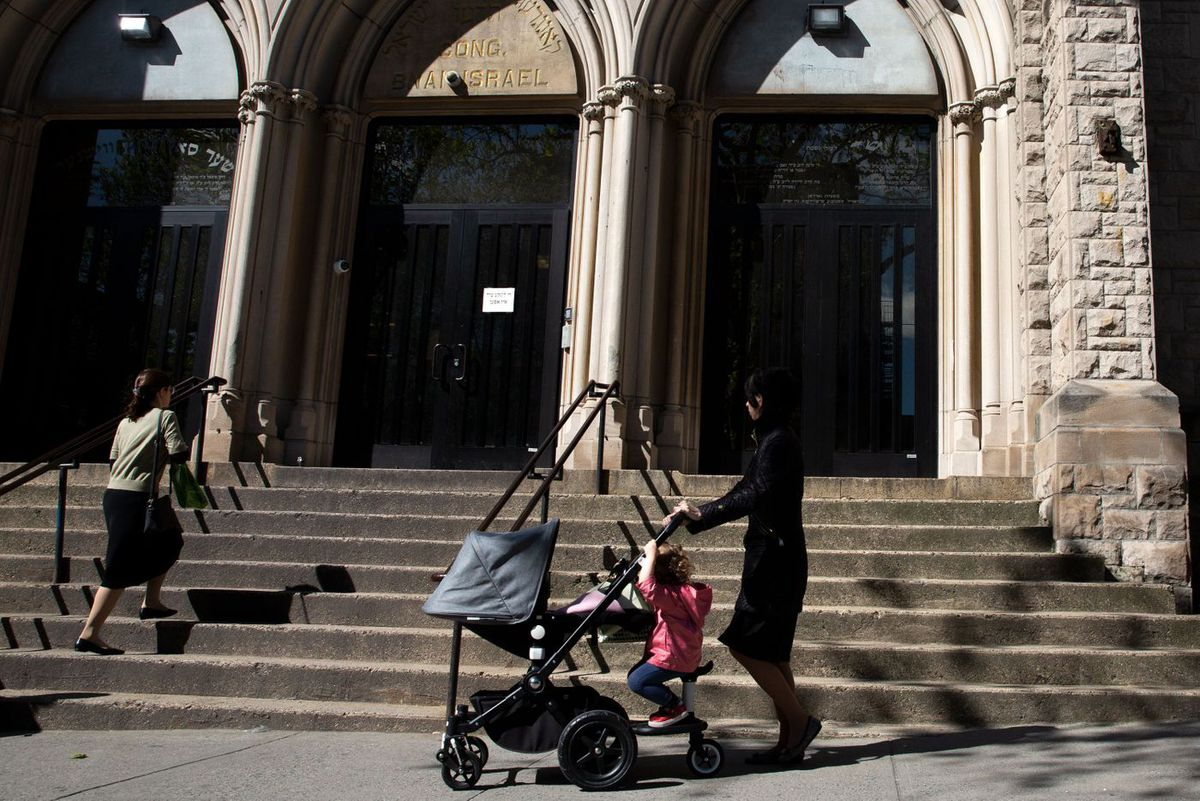 Parents and children walk through a South Williamsburg Orthodox Jewish neighborhood were Mayor Bill de Blasio named a health emergency after a measles outbreak, May 21, 2019.