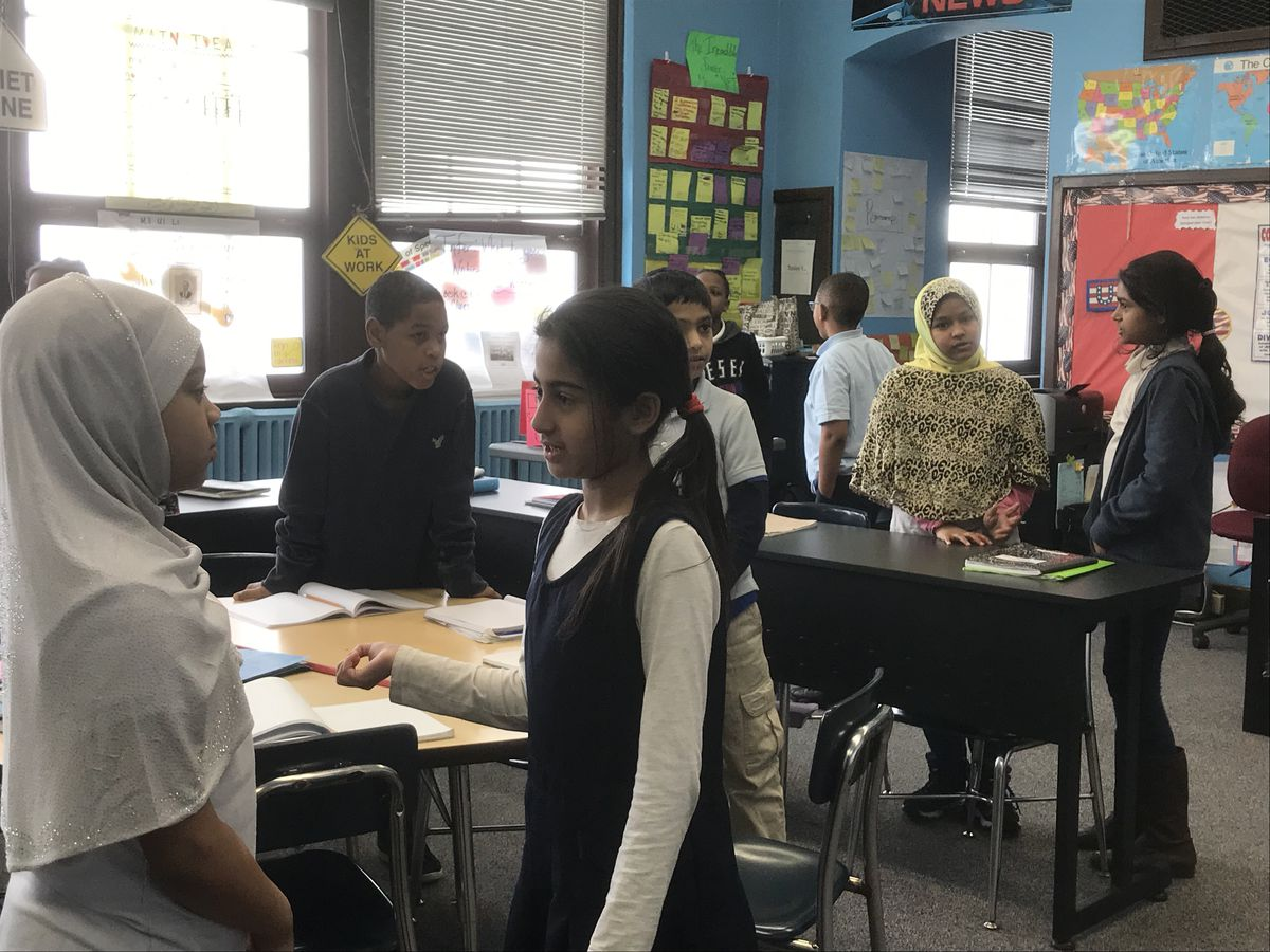 Kenya Posey's fourth-graders team up to share their ideas about who the loyalists were during the American Revolution.