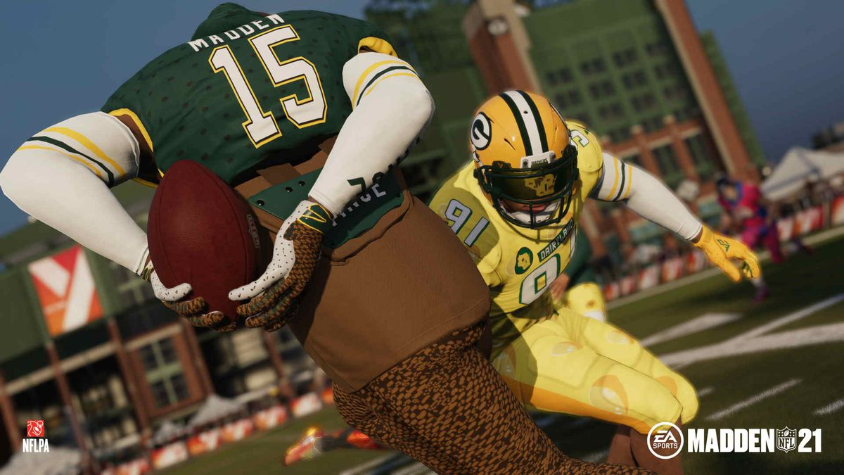 a player hides the ball behind his back to avoid a defender in Madden NFL 21's The Yard