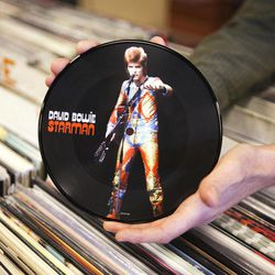 """A copy of David Bowie's """"Starman"""" record is seen, Thursday, April 19, 2012, in Scarborough, Maine. The seven-inch vinyl record is being released for Record Store Day on Saturday, April 21."""