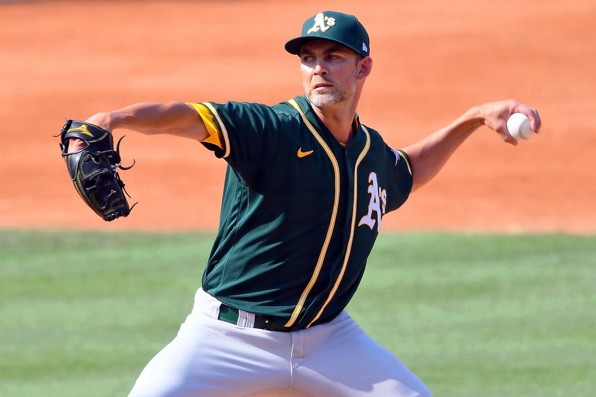Oakland Athletics starting pitcher Mike Minor (23) pitches against the Houston Astros during the fifth inning during game four of the 2020 ALDS at Dodger Stadium.
