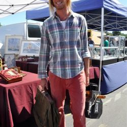 """<a href=""""http://la.racked.com/archives/2011/10/25/morgan_at_the_rose_bowl_flea_market.php"""" rel=""""nofollow"""">Morgan</a>'s shirt is from Ralph Lauren, the pants are Fred Perry, and his sunglasses and shoes are vintage. <br /><br />Photo by <a href=""""http://daz"""