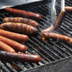 Hot dogs and sausages on the grill at the Taste To-Go pop-up event at Pullman City Market.