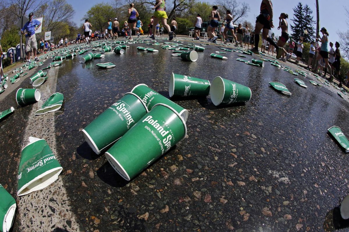 April 16, 2012; Newton, MA, USA; Used water cups cover the pavement near a water station at the 19 mile marker during the 2012 Boston Marathon.  Mandatory Credit: Greg M. Cooper-US PRESSWIRE