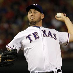 Texas Rangers starting pitcher Matt Harrison (54) delivers to the Cleveland Indians in the fourth inning of a baseball game Tuesday, Sept. 11, 2012, in Arlington, Texas.