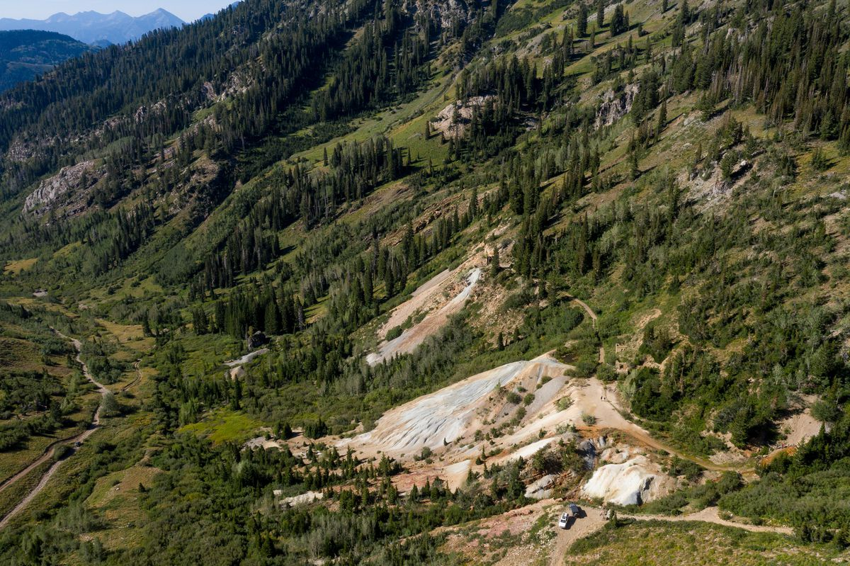 People who accessed the area by 4-wheel-drive road explore near piles of tailings, the waste product left over from mining operations, at the former Yankee Mine in Mary Ellen Gulch, a basin near the top of American Fork Canyon, on Saturday, Aug. 15, 2020.