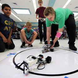Student Joshua Herman of West Jordan Middle School puts his robot in the ring for competition as middle school students who have been involved in an after-school STEM program compete in West Jordan on Wednesday, May 27, 2015.