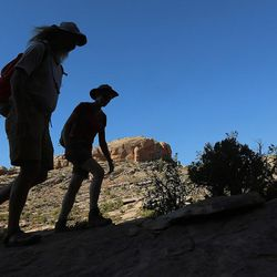 Interior Secretary Sally Jewell hikes with guide Vaughn Hadenfeldt toward Comb Ridge as she visits rock art sites, some of which have been vandalized in southern Utah on Saturday, July 16, 2016.