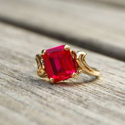 """<b>Gold West Vintage</b> Vintage Gold Slant Ring with Pink Emerald-Cut Gemstone, <a href=""""http://www.goldwestvintage.com/products/gold-slant-ring-with-pink-square-stone"""">$650</a>"""