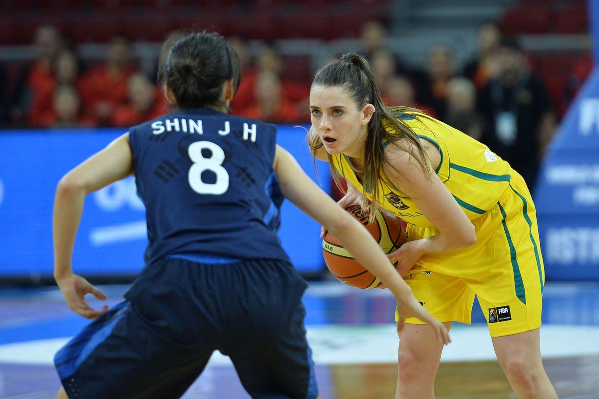 Australia's Tessa Lavey handles the ball as Korea's Jihyun Shin defends her in a Sunday game.