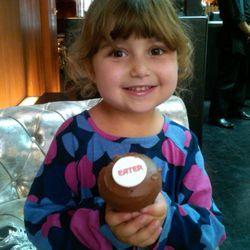 Eater's favorite visitor to the Lounge, Amanda Capon, enjoys a custom made cupcake.
