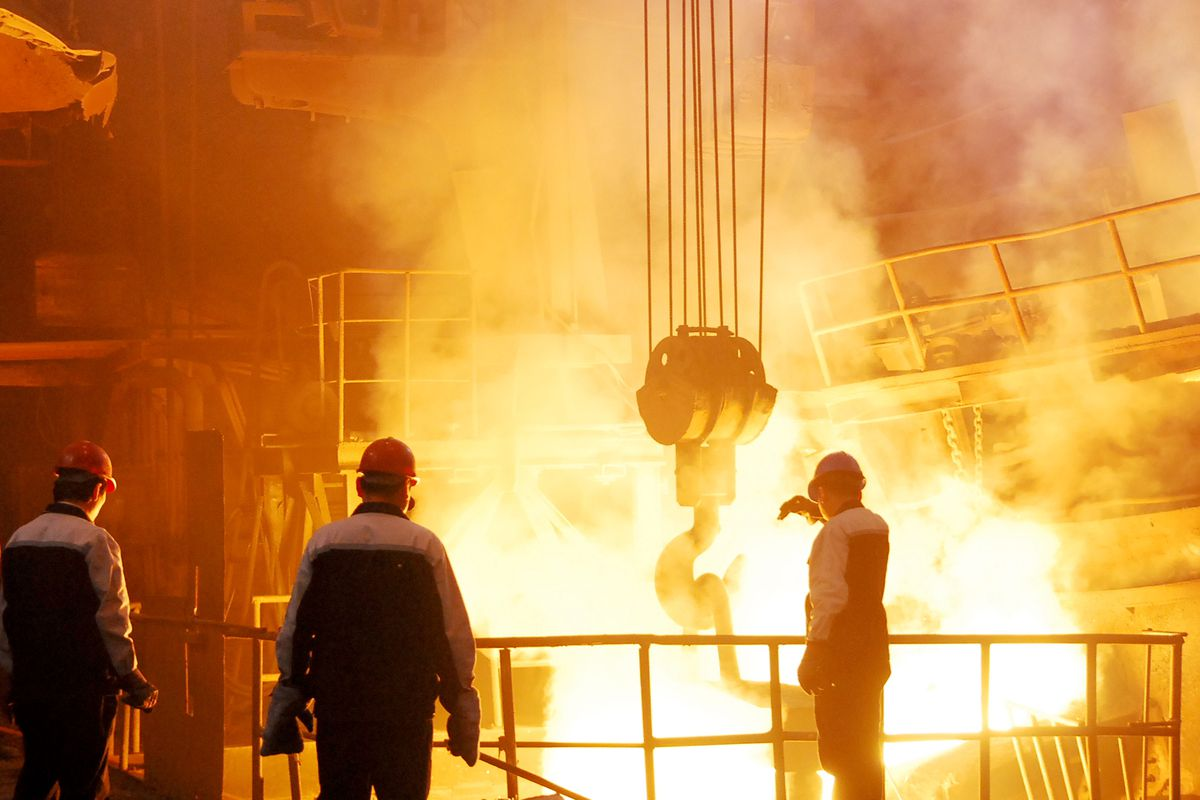 Metalworkers work at a steel factory of Shenyang Heavy Machinery Group Ltd. Co. on May 18, 2009 in Shenyang of Liaoning Province, China.