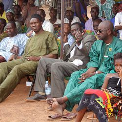 Niankoro Yeah Samake, center, visits with local villagers during his campaign for mayor in the Ouelessebougou region of Mali.