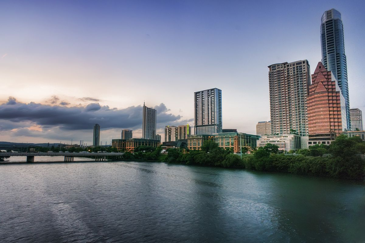 Austin skyline shot from southeast part of lake, partly cloudy, late afternoon