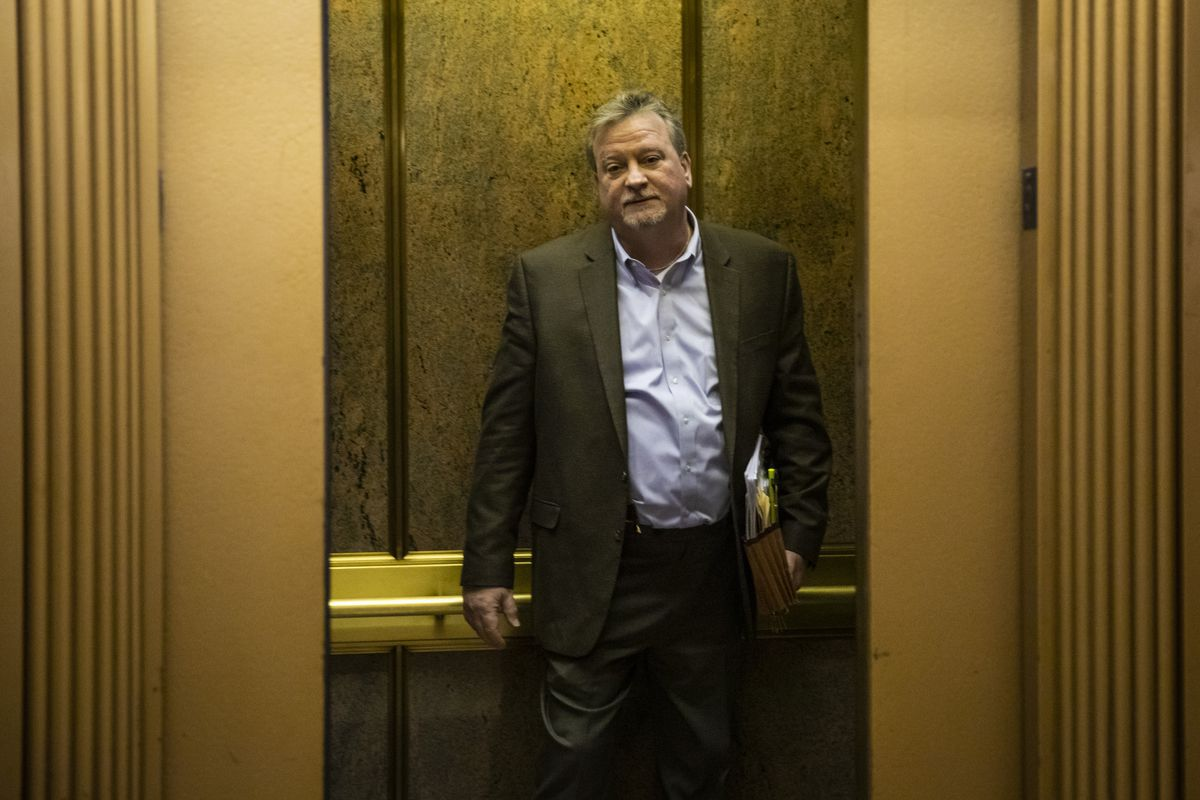 Cook County Commissioner Jeffrey Tobolski gets on an elevator to leavethe County Building in 2019.