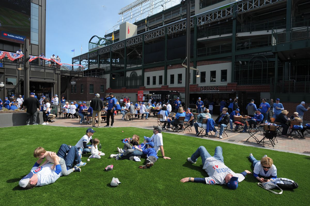 Fans relax at Gallagher Way, just outside Wrigley Field, before the Cubs' 2019 home opener in April.