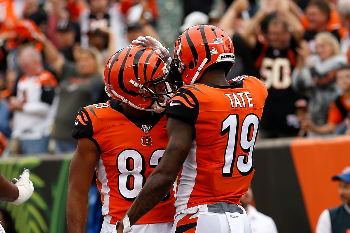 Auden Tate of the Cincinnati Bengals is congratulated by Tyler Boyd after scoring a touchdown during the fourth quarter of the game against the Arizona Cardinals at Paul Brown Stadium on October 6, 2019 in Cincinnati, Ohio.