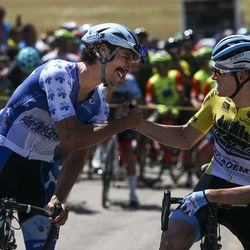 Wildlife Generation Pro Cycling rider Sam Boardman, left, shakes hands with Israel Cycling Academy and General Classification lead rider Ben Hermans at the start line before Stage 3 of the Tour of Utah on Antelope Island on Thursday, Aug. 15, 2019. Hermans went on to win the stage and maintain his yellow leader's jersey.