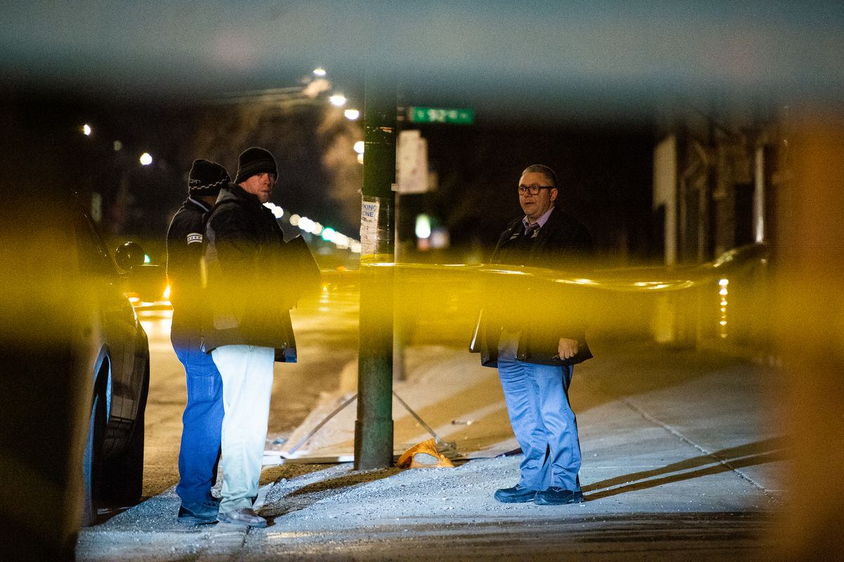 Chicago police investigate the scene where a 45-year-old man was found critically wounded in a shooting, Sunday night in the 9200 block of South Cottage Grove, in the Burnside neighborhood. | Tyler LaRiviere/Sun-Times