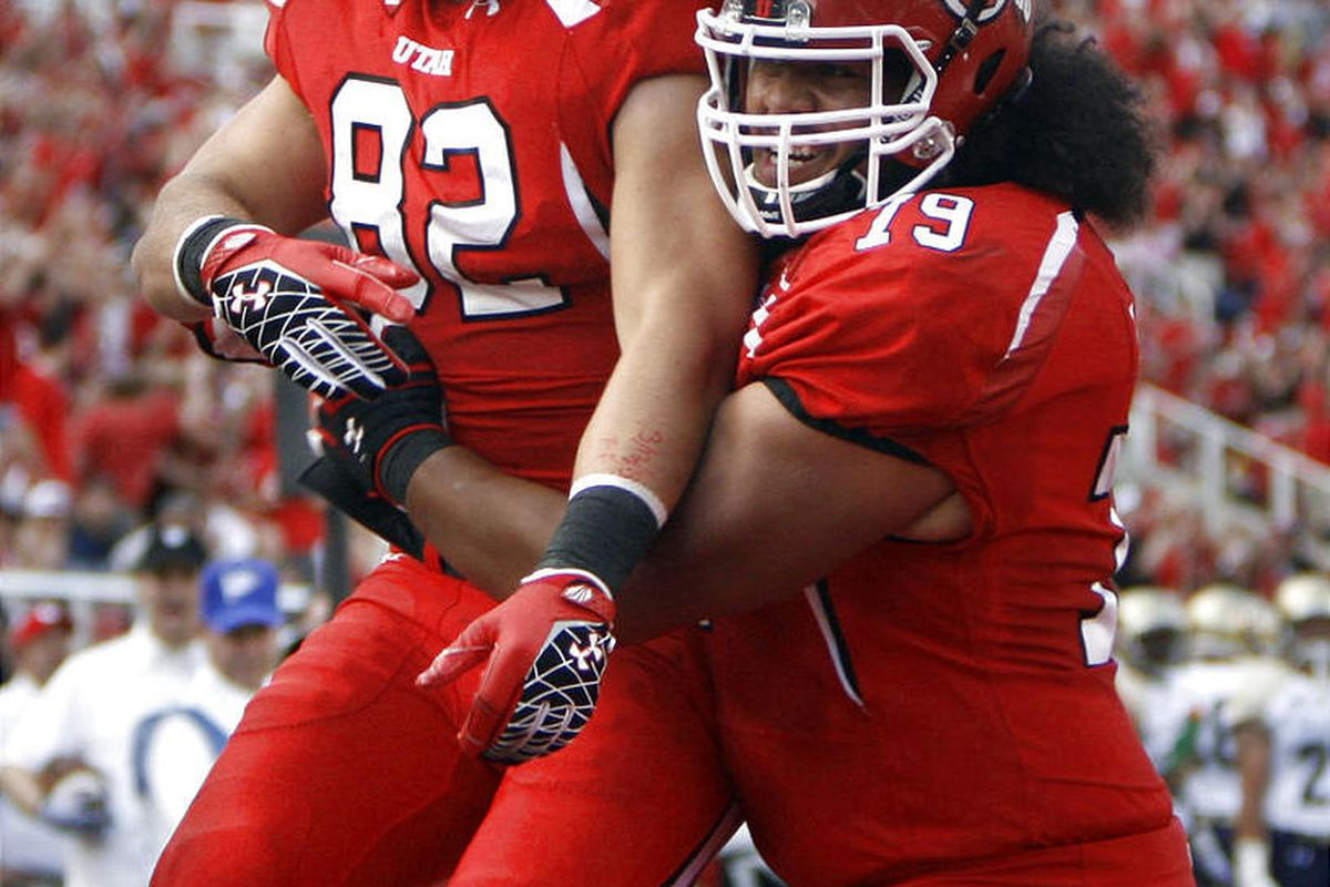 Utah's Jake Murphy and Percy Taumoelau celebrate Murphy's touchdown during the Utah Utes vs. Northern Colorado Bears game at the University of Utah on Thursday, August 30, 2012.