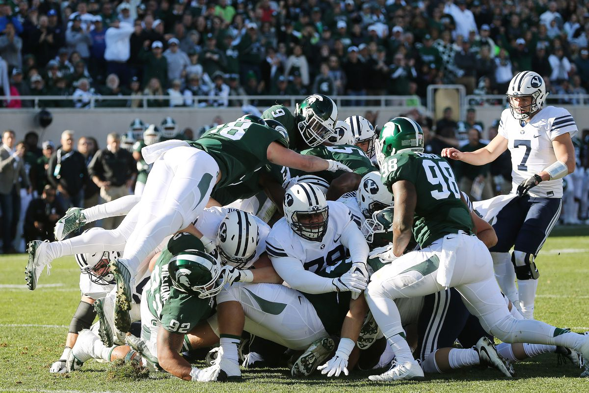 Brigham Young Cougars are held on a fourth down near the goal line by the Michigan State Spartans in East Lansing, Michigan, Saturday, Oct. 8, 2016. BYU won 31-14. The Big Ten made it official that the league's schools will only play a conference-only schedule in 2020. Michigan State was scheduled to play at BYU this season, on Sept. 12.