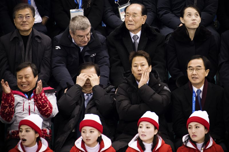 "North Korean cheerleaders react as (top left to right) South Korea""s President Moon Jae-in, president of the International Olympic Committee Thomas Bach, North Korea""s ceremonial head of state Kim Yong Nam, and Kim Yo Jong, the sister of North Korea""s lea"