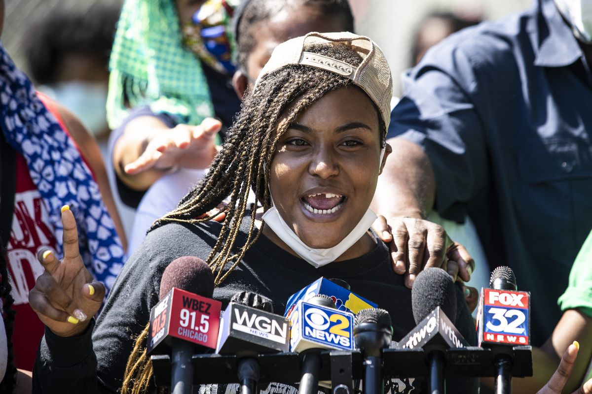 Miracle Boyd, an activist with GoodKids MadCity, speaks during a news conference in front of a statue of President George Washington near East 51st Street and South King Drive.
